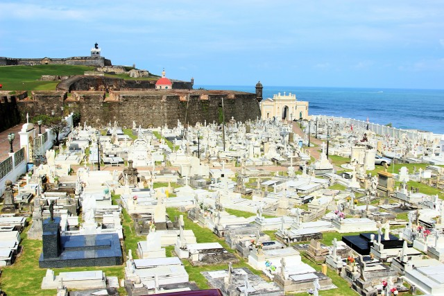 Morro Castle in the background along with the church and grave yard by the ocean.