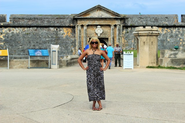 Africah standing at the entrance of the Castillo San Felipe del Morro.