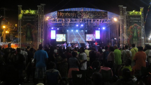 Rudy Live performing at a concert in Carnival Village.