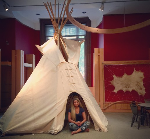 Africah hanging out in the  Teepee.