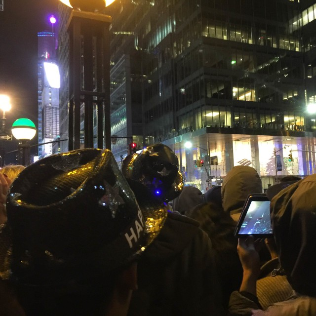 Millions of revelers watch the New Year's Eve Ball Drop.