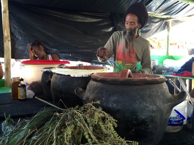 Ras Imani serving vegan food from the yabba pots.