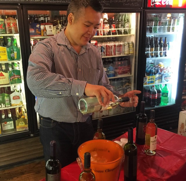 The manager pouring the wine.