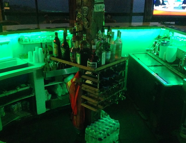 The lights change to a green color by the bar.